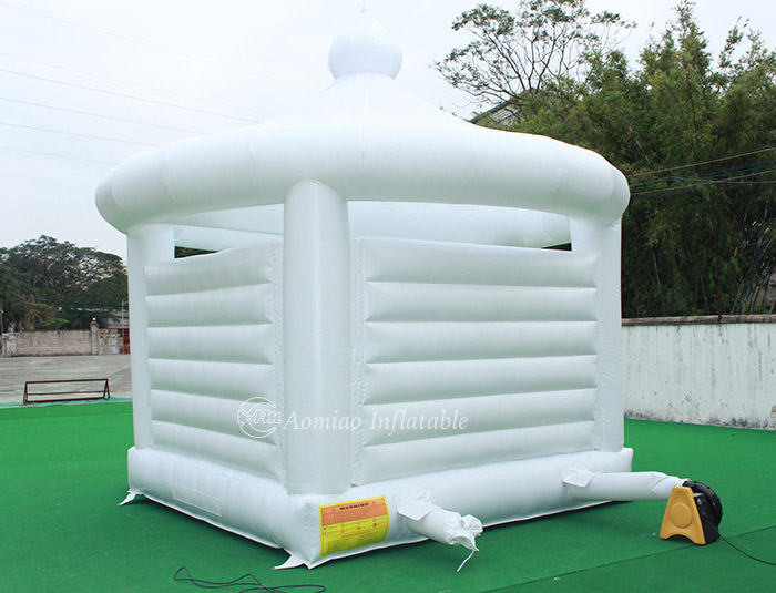 white inflatable bouncer